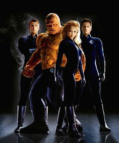 The FANTASTIC FOUR are (left to right): Chris Evans (as The Human Torch), Michael Chiklis (The Thing), Jessica Alba (The Invisible Woman) and Ioan Gruffudd (Mr. Fantastic).  http://www.movpins.com/dHQwMTIwNjY3/fantastic-four-(2005)/still-4180383744