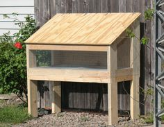 """Easter + 8 year old daughter = Rabbit. So today I built a hutch from some scrap wood I had in the garage with the assistance of the afore mentioned daughter. Rabbit investigates new home. """"Ho…"""