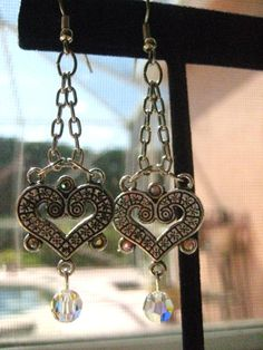 Antiqued Silver Heart Chandeliers With Swarovski Crystals https://www.etsy.com/listing/92700601/antiqued-silver-heart-chandeliers-with?ref=shop_home_feat