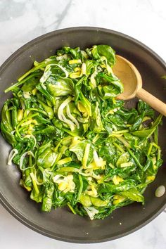Sautéed spinach and leeks is a quick + easy, healthy side dish with simple ingredients and delicious flavor! | www.familyfoodonthetable.com