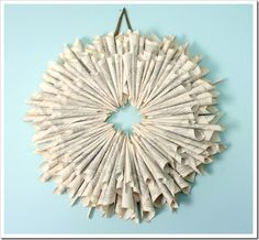 diy bookpage wreath... the tutorial is kind of hilarious- roll & glue, roll & glue, repeat 350 times.  sounds like we should have a wreath making party?!
