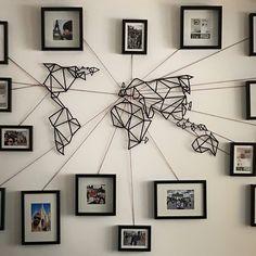 Photowall with geometric world map.