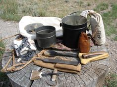 possible bagIncluded in my possibles bag is a sewing kit, a small cooper trade kettle, some tobacco, an awl, a file in a leather pouch, horn spoon, folding knife, coffee, meat hooks with chain, a small tin cup and my fire kit with flint and steel.