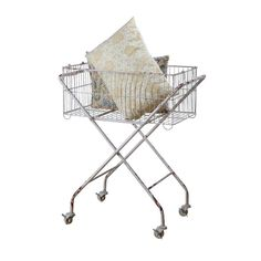 Oh versatile piece! Chic in a shabby, industrial way, Fitting tons of decors. Perfect beside the tub, for towels & bath goods. Craft rooms-store materials by theme all  or use to hold a current project & work anywhere. LOVE Metal Storage Basket   dotandbo.com