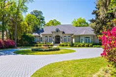 25005 Marsh Landing Parkway #PonteVedraBeach, #FL 32082  Spectacular 2 story traditional home on 1 of the prettiest lots in Marsh Landing. The 1.1 acre lot complements this gorgeous home w/ 100's of azaleas, hydangeas, holly ferns & roses wrapped around 2 stone patios, 160' of curving stone walkways & 2 water fountains. #Florida #RealEstate