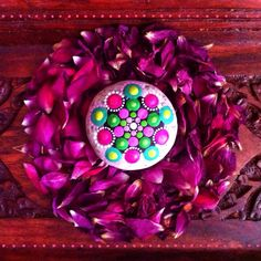Mandala stone on a bed of mini rose petals by Elspeth McLean  #mandala #paintedrock #rockart #paintedstone #jewel #rosepetals #display