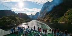 People on deck in the Trollfjord Trollfjorden and Raftsundet  Fjords that cut inland through towering mountain ranges