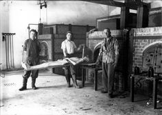 Dachau, Germany, Ex-prisoners from the camp demonstrating the insertion of a prisoner's dead body into the crematorium, after the liberation, 1945.