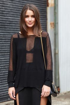 Street Style Inspiration: Throw on a little lace #bralette number underneath to add interest to any all black outfit.