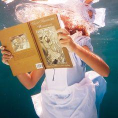 the best way to read alice in wonderland: via http://www.elenakalisphoto.com/portfolio/