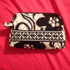 Vera Bradley pouch Bought this a while back, I have another one, so I don't really need it. Only used it to hold a couple bracelets in. So wear what so ever. Retired pattern. Vera Bradley Bags