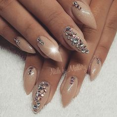Nude nails with bling.