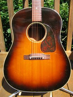 My dad owned a guitar like this VINTAGE GIBSON J-45 ACOUSTIC GUITAR CIRCA 48-51. I still have it.  mg