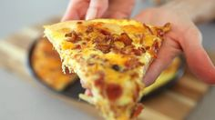 Everyone loves this easy Bacon Egg and Cheese Breakfast Pizza - watch our quick video tutorial to see how to make this yummy recipe!