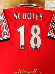 Official Umbro Manchester United home football shirt from the 1998/1999 season. Complete with Scholes #18 on the back of the shirt in official Lextra Premier League lettering.