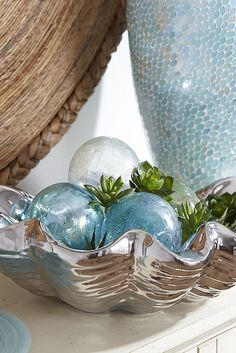 Every space needs something shiny. We're partial to this dazzling Pier 1 Silver Shell Bowl. Handcrafted from heavy stoneware, each shell is plated with reflective silver metal, creating the perfect bit of bling for coffee table, console or countertop. Display alone or as a holder for soaps, jewelry or decorative objects. Great for gifting, too.