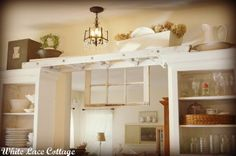 White Lace Cottage: A Step Above~Dreamy White Ladder above cabinets and a window Decorating Above Kitchen Cabinets, Above Cabinets, Pantry Cabinets, Open Cabinets, Vintage Ladder, Vintage Decor, Antique Ladder, Rustic Ladder, Layout Design