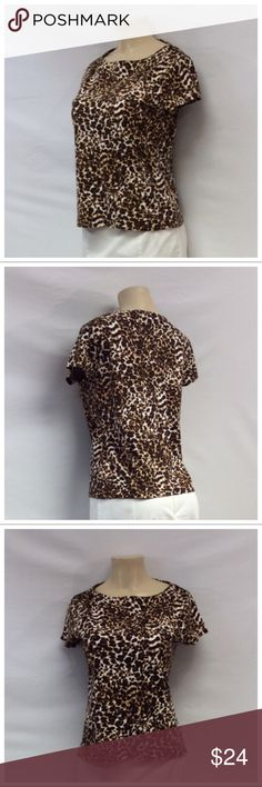 "JONES NEW YORK Leopard Print Top JONES NEW YORK Leopard Print Top, Size M, 100% cotton, machine washable. Approximate measurements are 19"" bust laying flat, 16"" shoulder seam to shoulder seam, 22"" shoulder to hem, 5"" sleeve from shoulder to end of sleeve. 0734 Jones New York Tops"