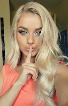 larger eyebrows, highlighted inner eyes, fake lashes, nude lips, bronzed skin and long blonde hair. perfect look