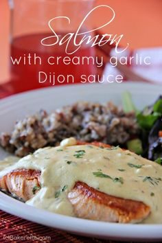 Pan seared salmon with creamy garlic Dijon sauce, bathed in shallots, white cooking wine, seasonings, garlic, and Dijon mustard.