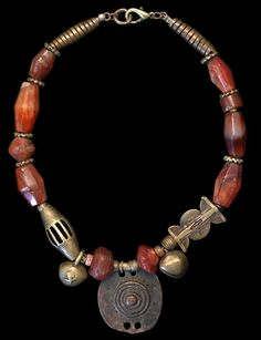 """Marion Hamilton, """"Carnelian agates of various ages are strung with c. Nigerian brass and an Ethiopian shaman's bronze amulet. Gypsy Jewelry, Tribal Jewelry, Jewelry Art, Beaded Jewelry, Vintage Jewelry, Jewelry Necklaces, Handmade Jewelry, Jewelry Design, Beaded Necklace"""