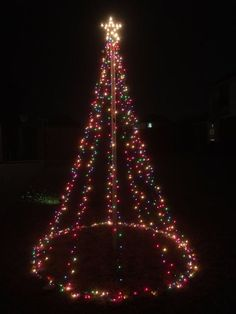 10 Ft Outdoor Christmas Light Tree Decoration: 6 Steps (with Pictures) Christmas Tree Out Of Lights, Outdoor Christmas Light Displays, Christmas Light Installation, Hanging Christmas Lights, Xmas Lights, Diy Christmas Tree, Christmas Lights Outdoor Trees, Christmas Ideas, Christmas Light Show