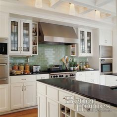 Like this kitchen, especially the stove back splash, reminds me of sea glass.
