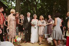 """Join two families with flowers: """"Both of our mothers carried a different wild flower to combine in one vase to symbolize the joining of two families. Later in the ceremony, instead of a unity candle, we each added a white daisy to the bouquet."""""""