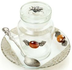 Glass Rosh Hashanah Honey Dish Jar and White Design by World of Judaica. $24.00. You will be pleasantly surprised! The vast majority of our shipments arrive within 10-14 business days from time of shipment, far in advance of Amazon's default calculation of shipping times for items shipped from Israel.. Dimensions: S -- 13 x 8cm. Your order includes 1 item(s).. Material: Glass. This glass jar for honey on Rosh Hashanah is decorated with a cluster of grapes atop its lid and c...