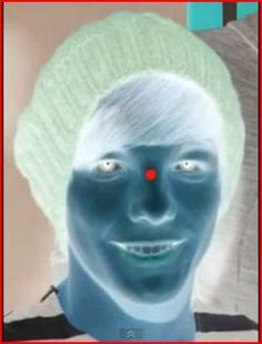 Look and stare at the red dot for 20-30 seconds. then look at a wall
