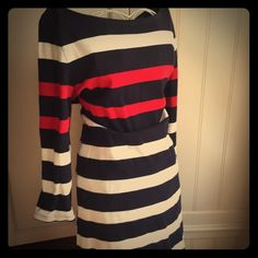 Lands End cotton striped dress I call this my yachting dress. 100% cotton, long sleeved with navy blue, red and white/ivory stripes. Perfect for a day at the club or on the yacht. Or pair with a denim jacket and pearls for a day of shopping. So comfortable and immensely figure flattering. Size medium fits 10/12. Gently worn with no flaws. Lands' End Dresses Long Sleeve