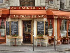 Au Train de Vie by nicoatridge, via flickr   Paris, France    Another bistro with an interesting name - a play on words. This bistro is located beside the Gare de l'Est and the chairs are old train seats.    The literal translation would be Life train but it can also mean the life being lived at a certain rhythm. A bit difficult to explain.