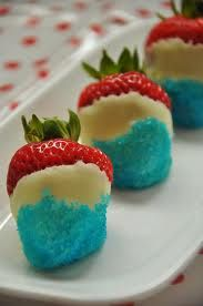 A July 4th Tradition.  Strawberries, white chocolate, blue sugar:)