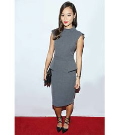 A conservative workplace demands covering up, but there are still incredibly chic ways to do it. At the Badgley Mischka store opening in New York, Chung struck a modest-meets-modern balance in her peplum dress by the designer and studded Alice + Olivia pumps.