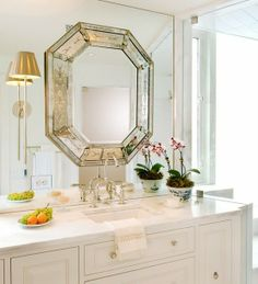 I love this way of dressing up a plain builder mirror--wonder how it's hung.....