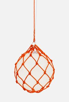 Fisherman pendant lamp from Zero has an opal white cup of UV-stable polyethene enclosed by a orange hand-woven mesh.