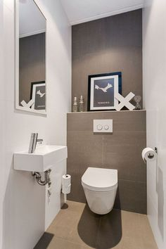 a neutral guest toilet done in taupe and white, an artwork, a wall mounted sink and a large mirror Small Toilet Room, Guest Toilet, Downstairs Toilet, Guest Bathrooms, Bathroom Sets, Bathroom Toilets, Bathroom Wall, Family Bathroom, Master Bathroom