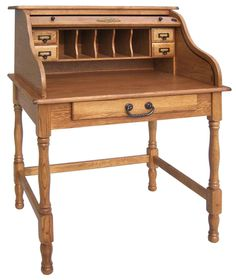 In love with this little roll top desk.