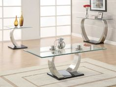 COFFEE TABLE -- COASTER 701238 by Coaster Home Furnishings. $373.00. Glass Top. Stylish Curved Base. durable and stylish. This Coffee Table by Coaster is an ultra modern table that features a floating glass top and large scaled satin finish metal support with a high sheen black base. Matching sofa and end tables are also available. Bring some fresh atmosphere into your home interior with this wonderful collection!Dimension: COFFEE TABLE -- COASTER 701238 (50x28x18.5)
