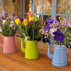 Cute idea old enamel(?) teapots