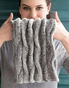 Gathered welts form a ruched effect that's equally lovely knitted in solid or variegated hues.