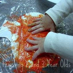 """Painting With Plastic Wrap""  Teaching 2  and 3 Year Olds. Nice sensory/art experience that is process-based and looks like lots of fun.  Originally Pinned by Alec Duncan of http://childsplaymusic.com.au/"