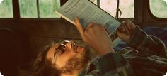 Emile Hirsch reading a book in Into the Wild