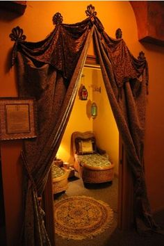 Love the detail of the curtains, how they're hung on the wall. It's somewhat ornate, but creative.