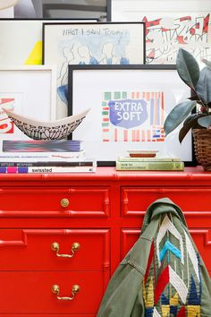 Eclectic vignette with vintage pieces, and a plant