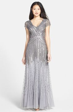 Free shipping and returns on Adrianna Papell Embellished Mesh Gown at Nordstrom.com. Silvery liquid-shine sequins angle across the glossy cap-sleeve bodice of a satin-waist mesh gown before showering to a faded finish down the sweeping, slightly trumpeted skirt.