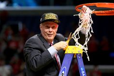 Wisconsin head coach Bo Ryan takes down the net and his Badgers return to the Final Four, beating Arizona, 85-78.