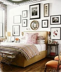 Nice gallery wall display with black and whites and a splash of color for this bedroom #walldecor #frames