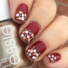 Super cute festive nail art - DIY using a bobby pin and metallic nail polish over red. #polkadotnailart