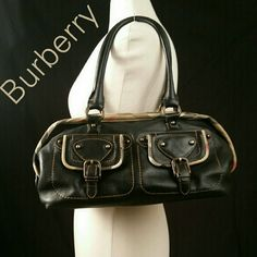 💠💠FLASH SALE💠💠Burberry Satchel This Burberry Satchel is perfect for carrying all of your essentials.  It features check coated canvas trim and supple  black leather. A timeless piece that never goes out of style. There  is minor wear on the bottom as noted pic. The interior is in good condition with light wear. Burberry Bags Satchels